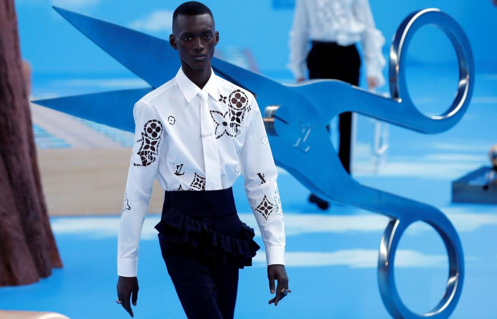 A lasercut shirt with the shapes of the Louis Vuitton monogram.