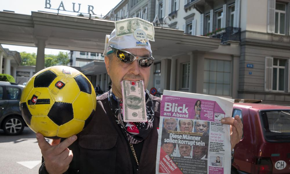A protester makes his point after a police raid at the hotel Baur au Lac in Zurich during the US investigation into Fifa corruption.