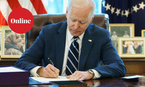 """US President Joe Biden signs the American Rescue Plan on March 11, 2021, in the Oval Office of the White House in Washington, DC. - Biden signed the $1.9 trillion economic stimulus bill and will give a national address urging """"hope"""" on the first anniversary of the start of the coronavirus pandemic."""