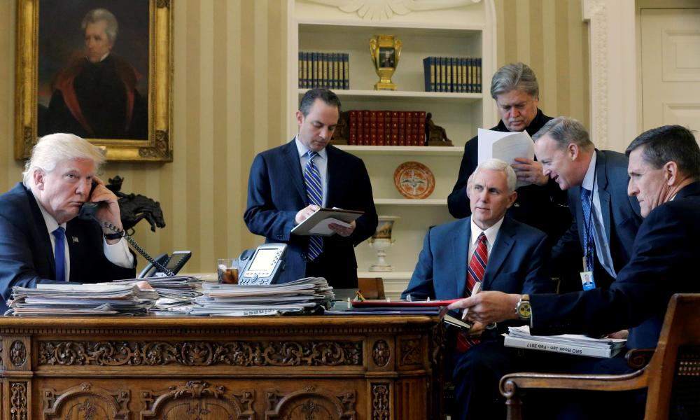 Trump speaks on the phone in the Oval Office, alongside Reince Priebus, Mike Pence, Steve Bannon, Sean Spicer and Michael Flynn. Only Trump and Pence still work in the White House.