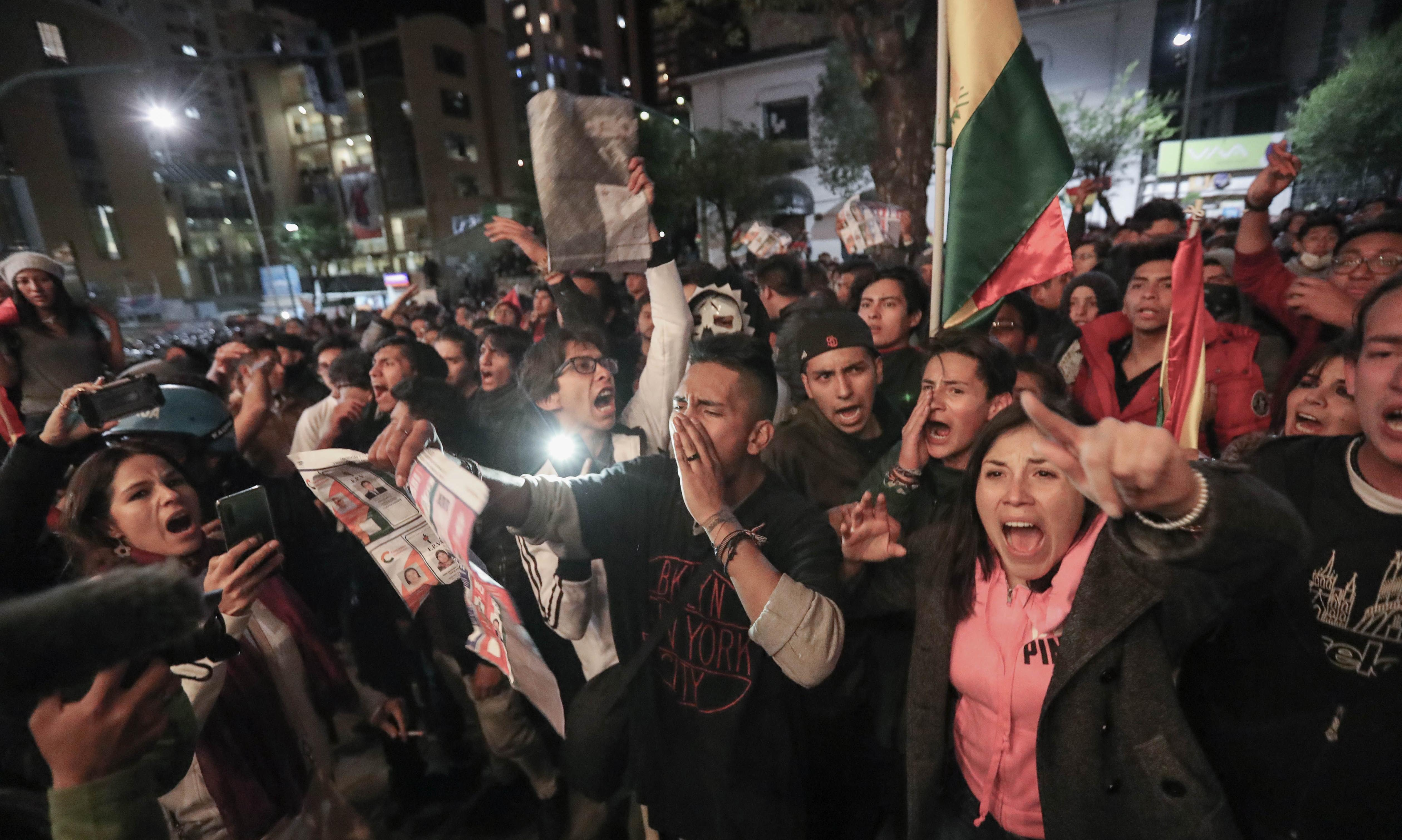 Bolivia braces for fresh protests as officials say Evo Morales close to victory