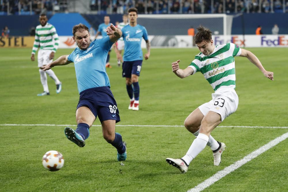 Celtic's Kieran Tierney crosses the ball under pressure from Branislav Ivanovic.