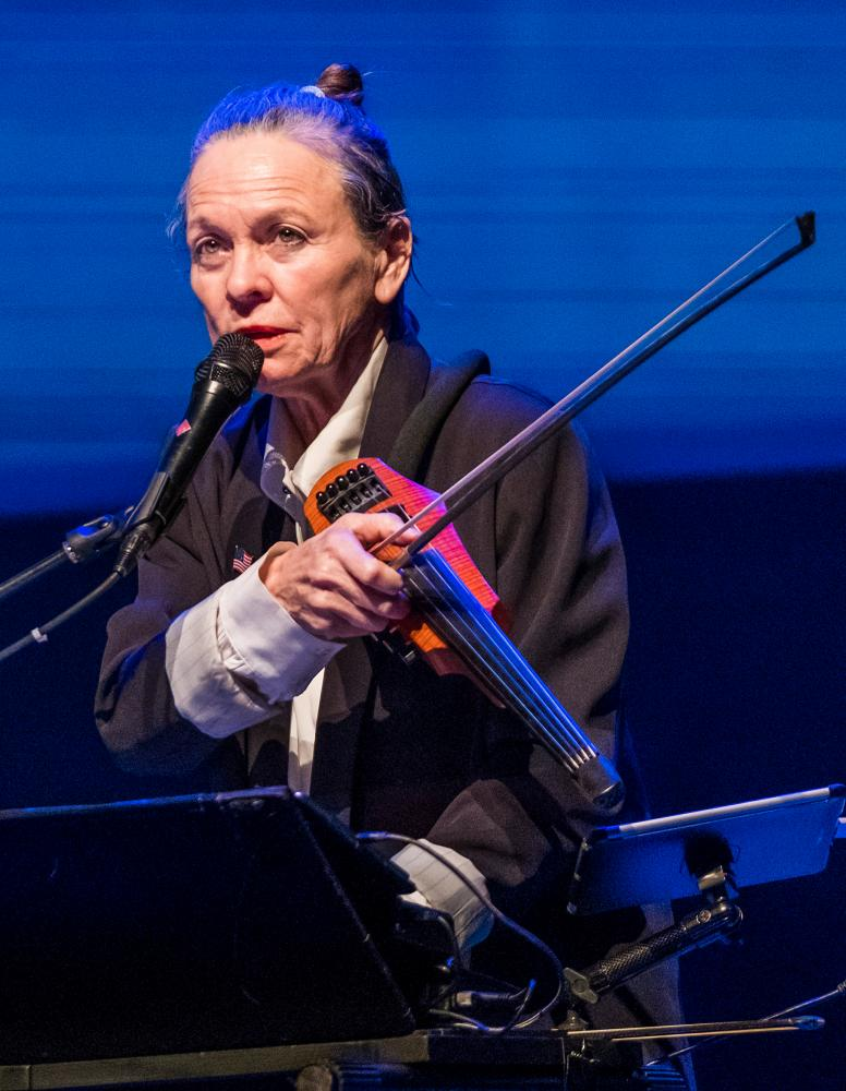 Laurie Anderson on electric violin.