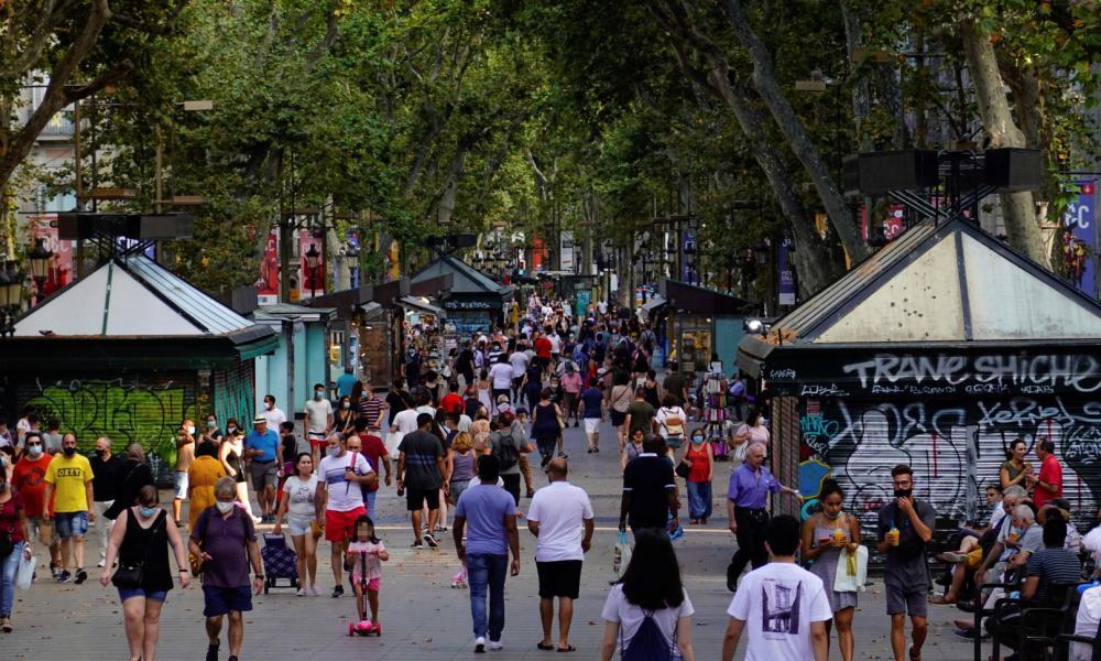 People stroll along the iconic Las Ramblas boulevard in downtown Barcelona, northeastern Spain, on Saturday.