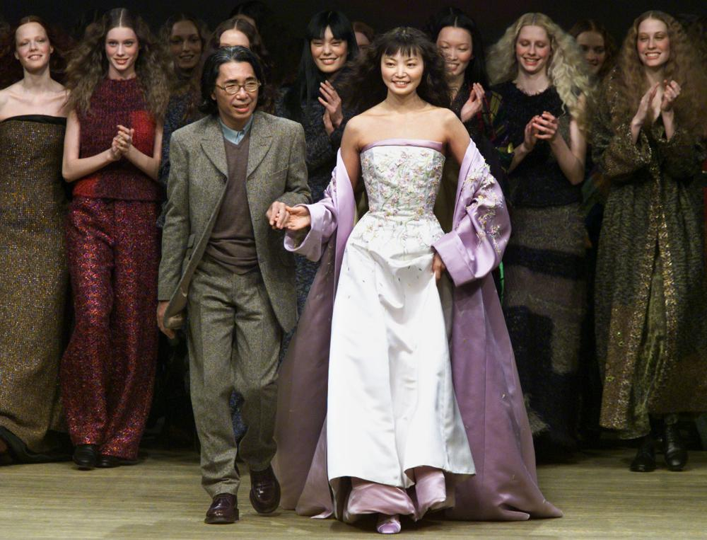 Kenzo takes to the catwalk with a model wearing a bridal gown at the end of his 1999/2000 autumn/winter ready-to-wear fashion show.