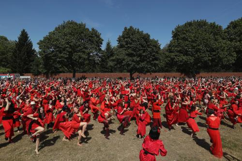 Men and women dressed as Kate Bush dance as they attempt to create a new world record for the most people dancing in costume to Wuthering Heights