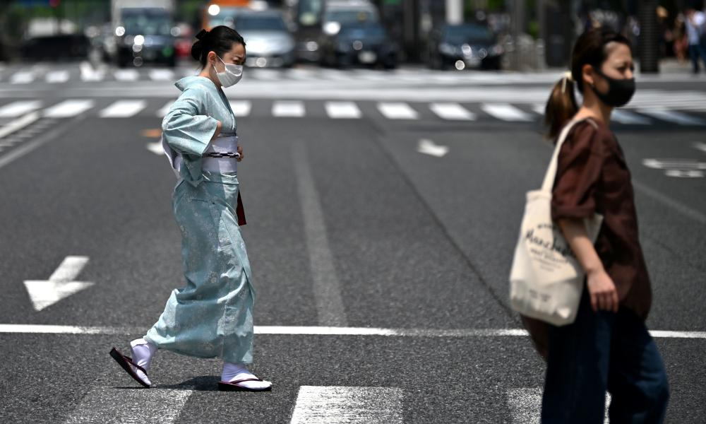 A woman wearing a kimono crosses a street in Tokyos Ginza area on 5 June 2020.