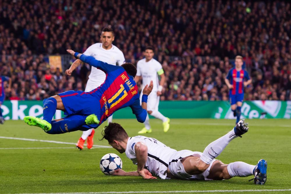 Neymar goes down.