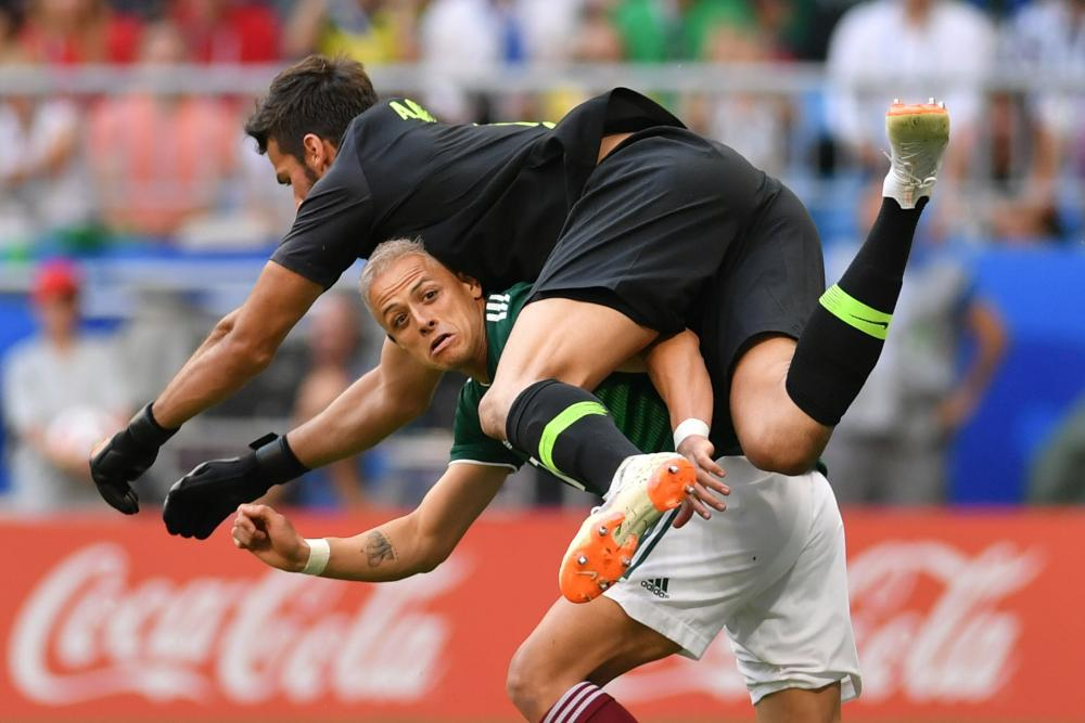 Javier Hernandez, jumped by Brazil's Brazil's goalkeeper Alisson.