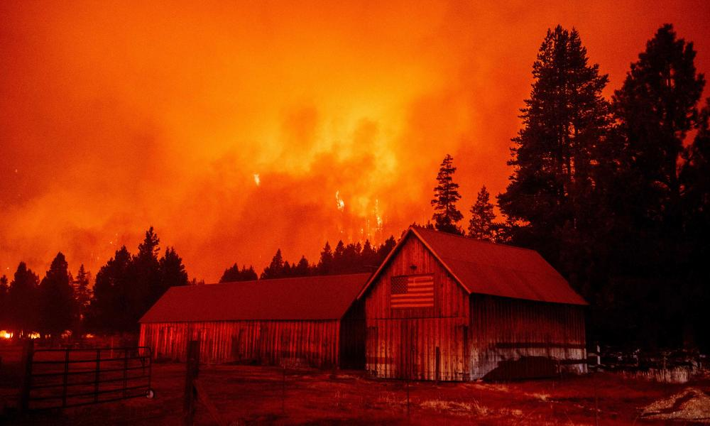 Flames consume multiple homes as the Caldor fire pushes into the Echo Summit area, California, last month.