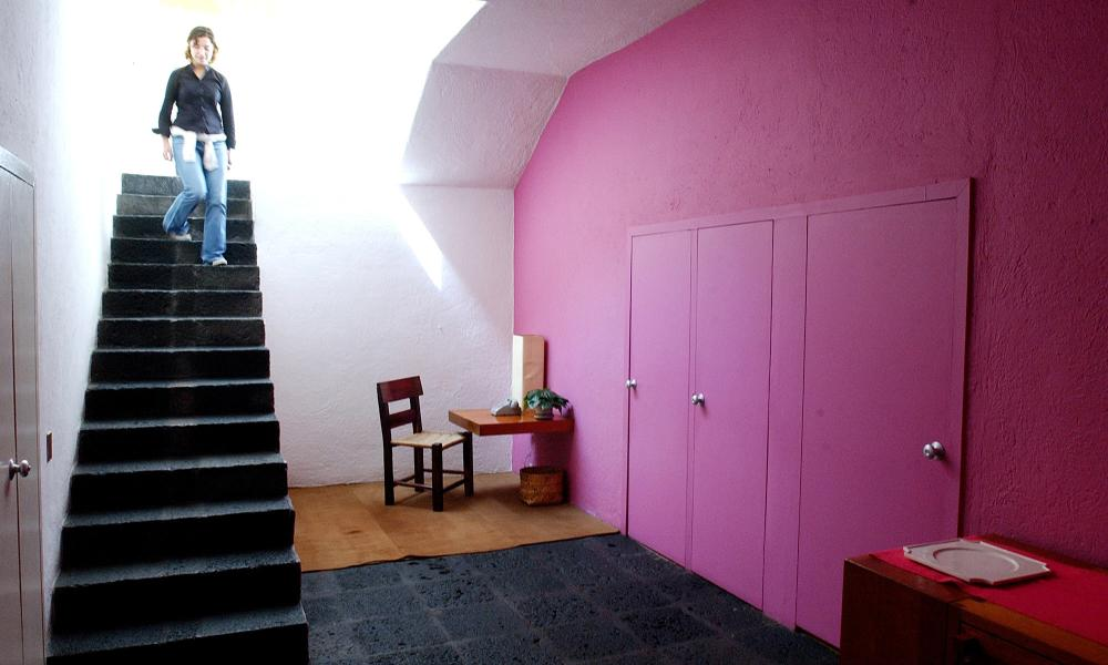 A visitor descends a staircase on a tour of architect Luis Barragan's home in Mexico City.