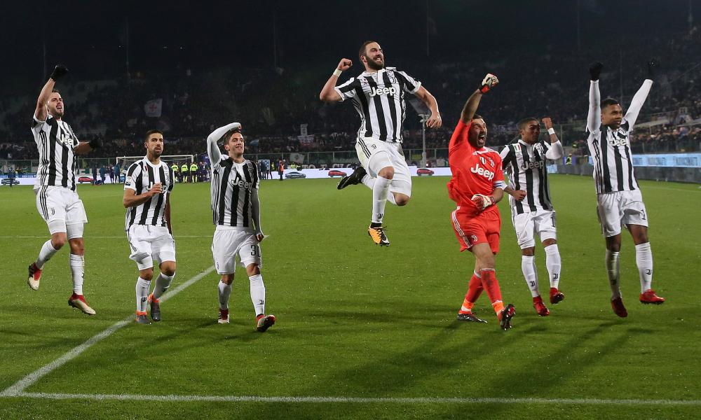 Juventus players celebrate after their win against Fiorentina.