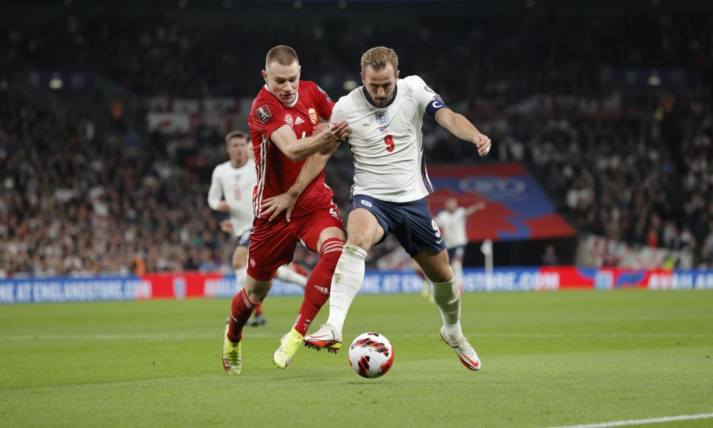 Harry Kane of England battles for possession with Attila Szalai of Hungary.