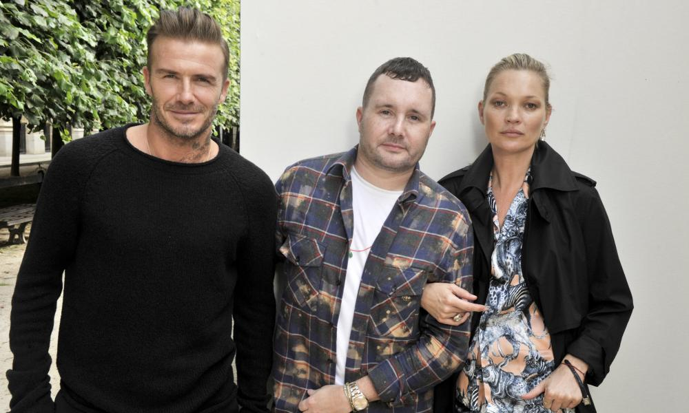 David Beckham and Kate Moss flank Kim Jones backstage at the designer's show