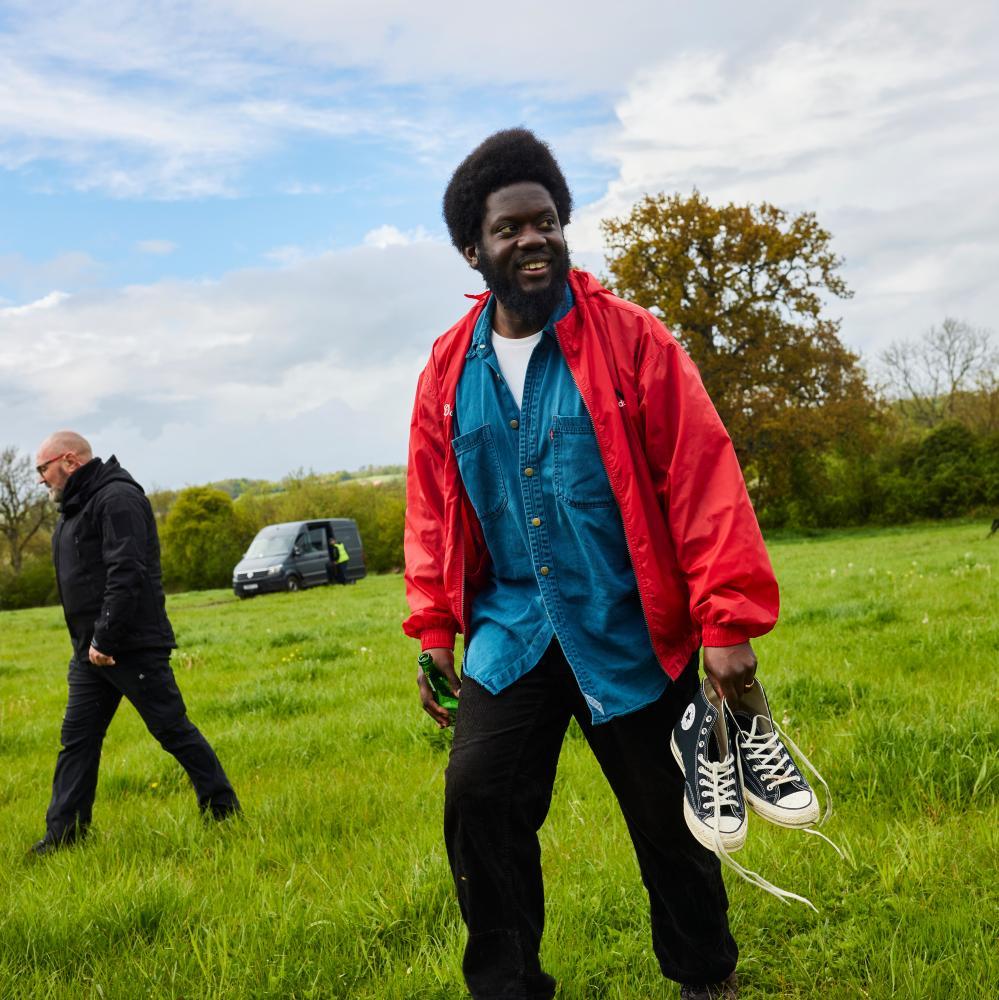 Michael Kiwanuka protecting his clean Converse.