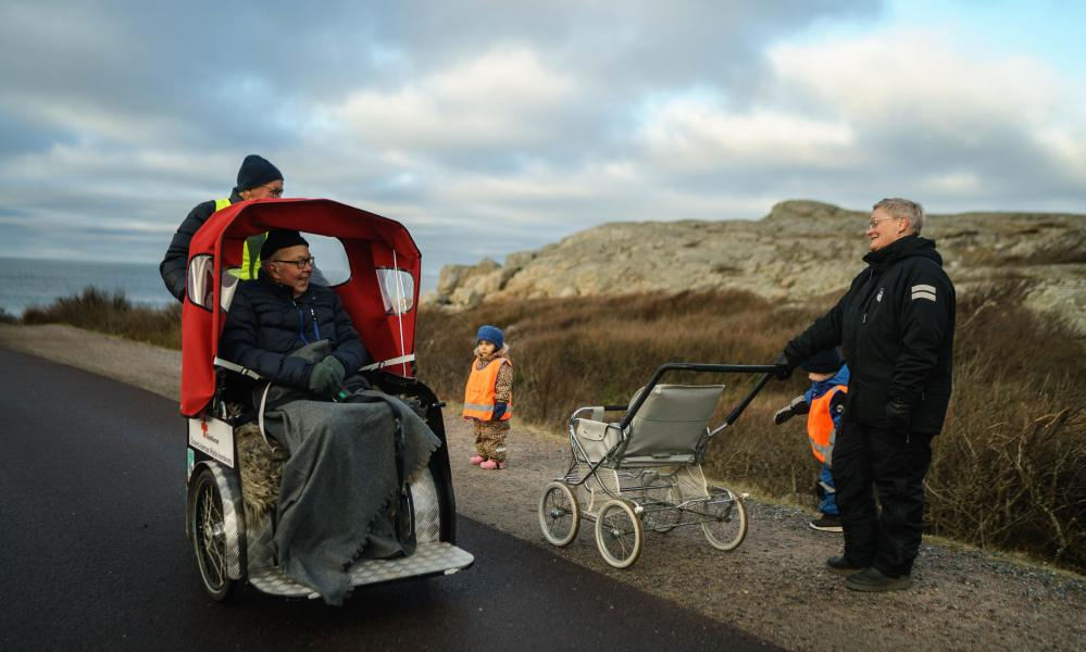 In Öckerö, Gothenburg, Morgan Simonsson cycles with his step-dad Ingvar Kristiansson on a ride they take once per week to help break Ingvar's isolation and be able to get outside during the pandemic.