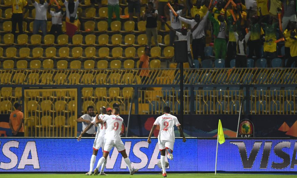 Benin's forward Mickael Pote (left) celebrates his goal with teammates in front of their happy fans.