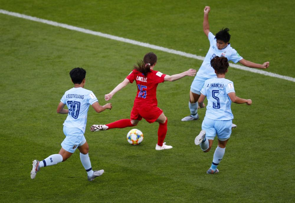 United States' Rose Lavelle, centre, fires in a shot to score her team's second goal.