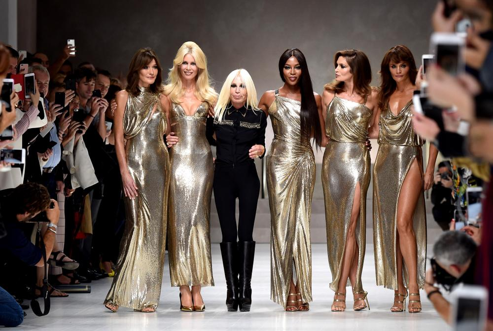 Carla Bruni, Claudia Schiffer, Naomi Campbell, Cindy Crawford, Helena Christensen and Donatella Versace walk the runway at the Versace show