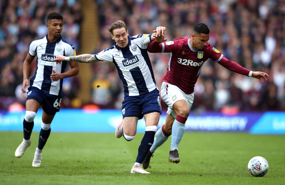 Aston Villa's Anwar El Ghazi (right) and West Bromwich Albion's Stefan Johansen battle for the ball.