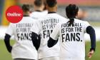 Leeds United players wearing 'Football Is For The Fans' shirts during the warm up prior to kick-off during the Premier League match at Elland Road, Leeds on Monday 19 April.