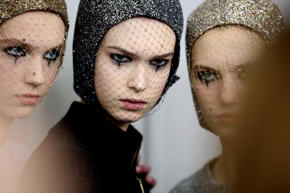 Eyeliner and mesh face masks: backstage at Christian Dior
