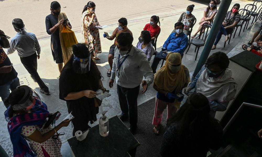 People queue to receive a dose of the Covishield, AstraZeneca-Oxford's Covid-19 coronavirus vaccine, at Max hospital in New Delhi on 1 May.