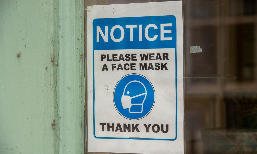 A face mask sign in a tailors in Eton, Windsor, Berkshire.