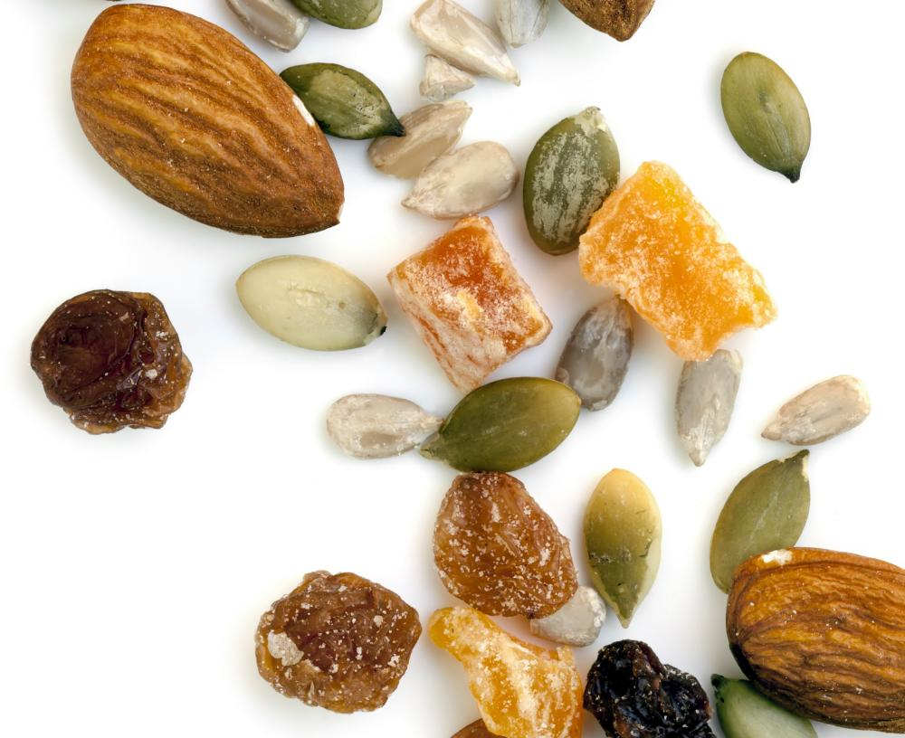 Trail mix of nuts and dried fruit isolated on white background