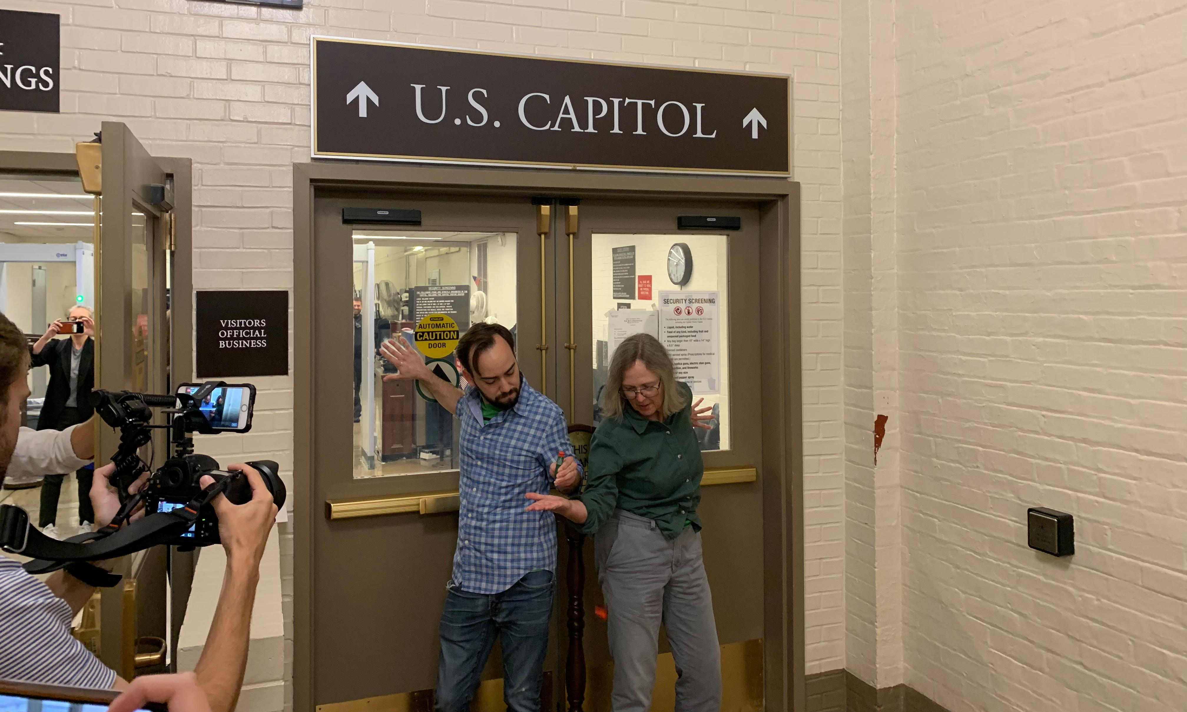 Extinction Rebellion protesters confront politicians at US Capitol