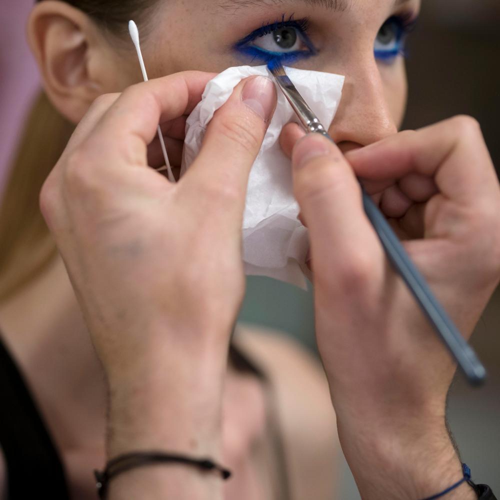 A makeup artist with a model