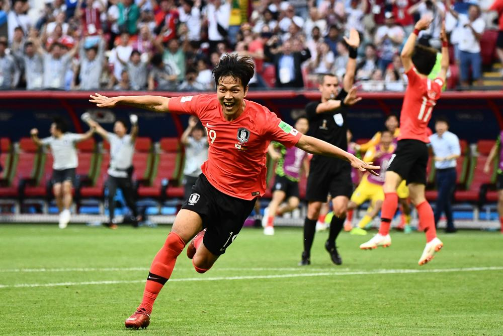 Kim Young-gwon gives South Korea the lead against reigning world champions Germany.
