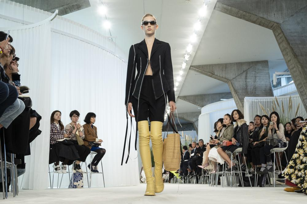 Loewe tailoring with thigh-high boots.