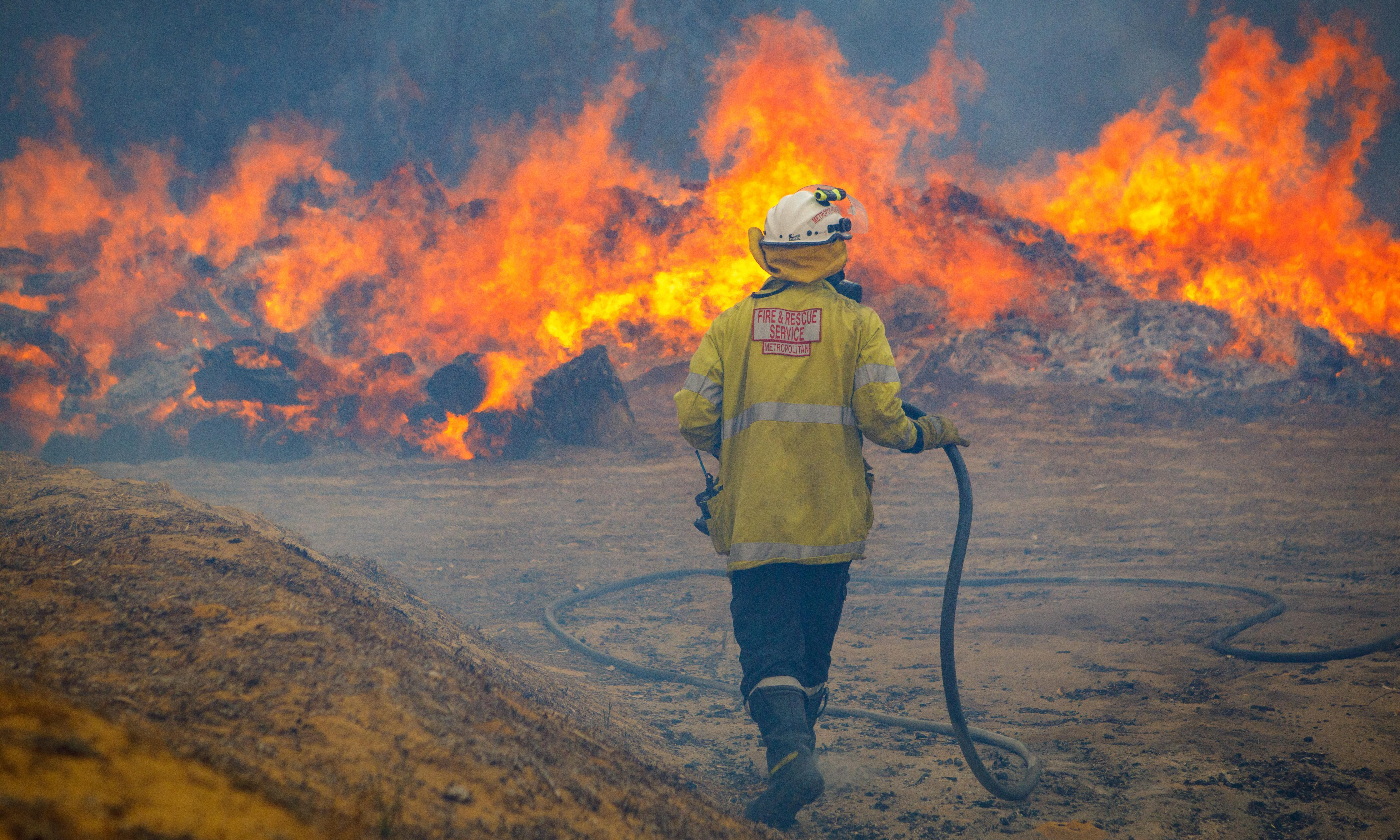 NSW fires: residents in path of 370,000ha bushfire near Sydney told it's 'too late to leave'