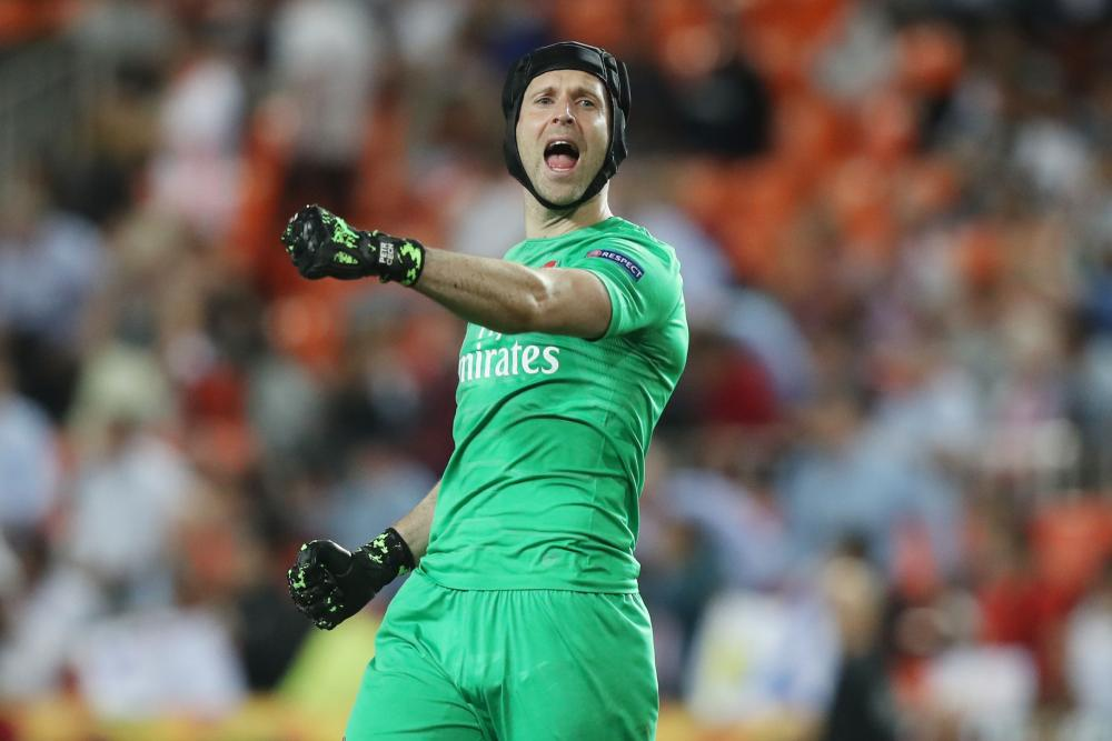 Cech celebrates at the end of the match.