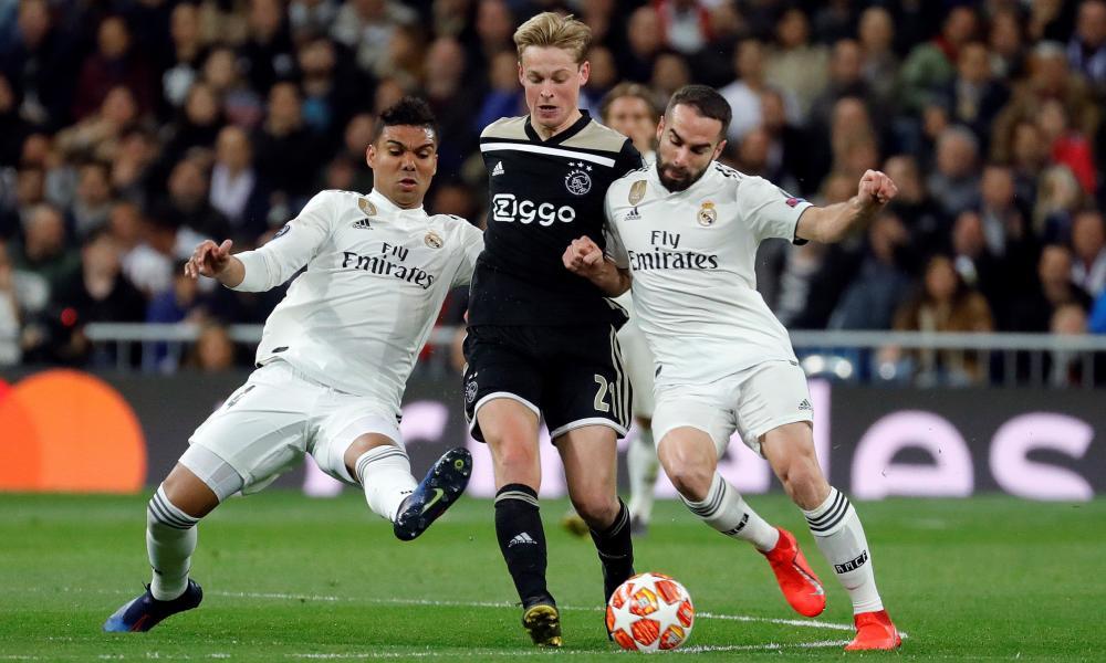 Real Madrid's Casemiro (left) and Dani Carvajal combine to try and dispossess Ajax's Frenkie de Jong.,