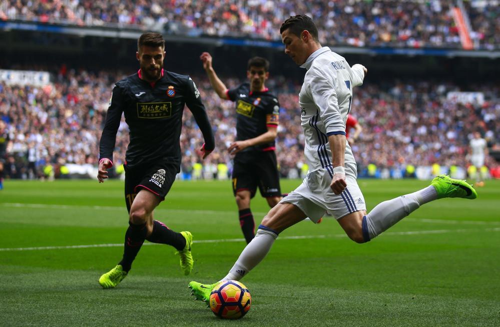 Cristiano Ronaldo looks to cross under pressure from David Lopez.