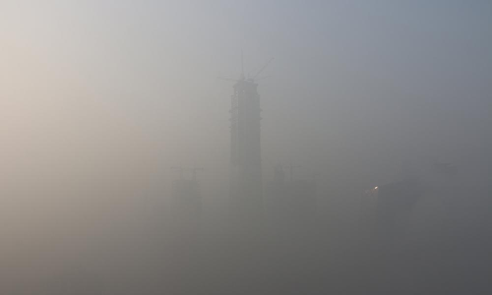 Landmark buildings are seen through smog on 1 January in Beijing.