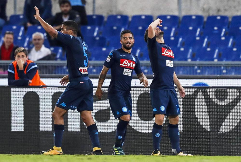Dries Mertens leads the celebrations after his goal by raising a toast.