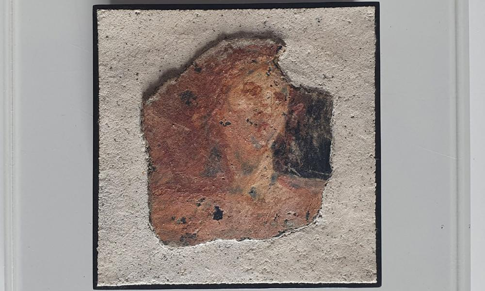 A fragment of a fresco depicting a female figure and lyre that was stolen from a Roman Villa near Pompeii