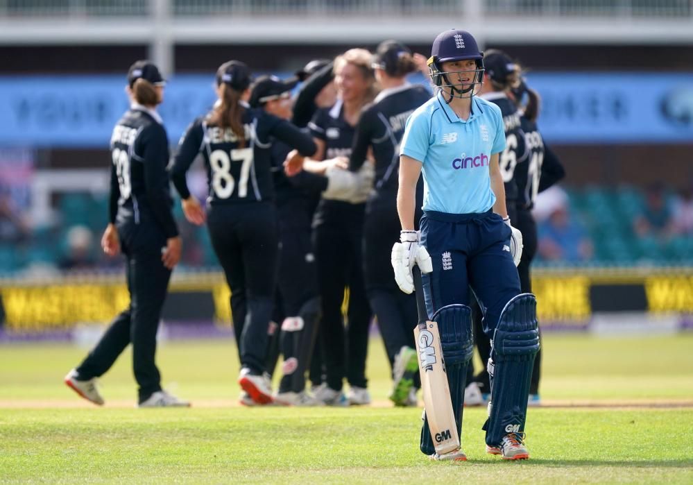 England's Amy Jones leaves the pitch after being bowled by New Zealand's Molly Penfold.