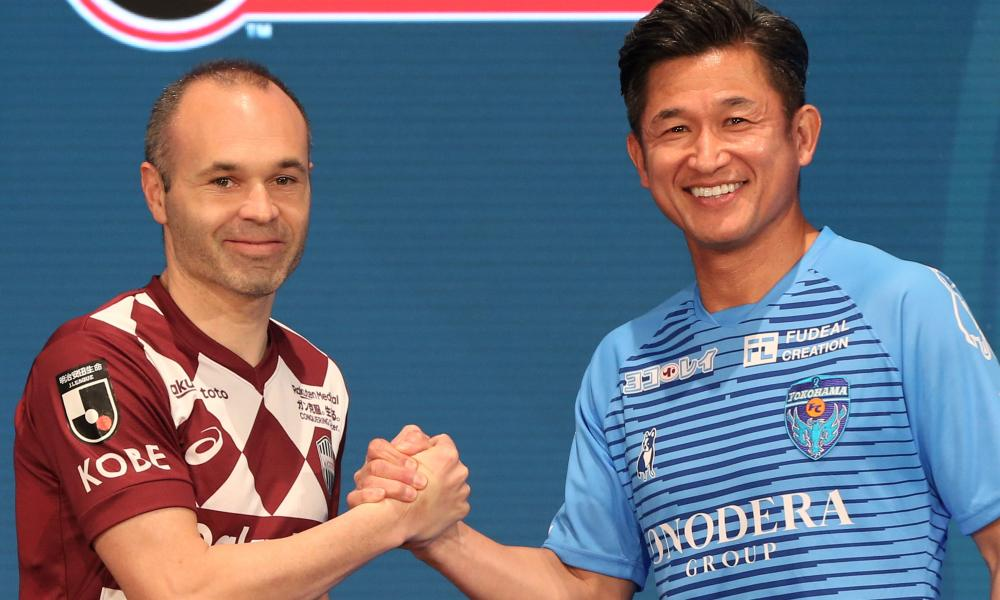 Andrés Iniesta (Vissel Kobe) and Kazuyoshi Miura (Yokohama FC) shake hands at the J League media day.
