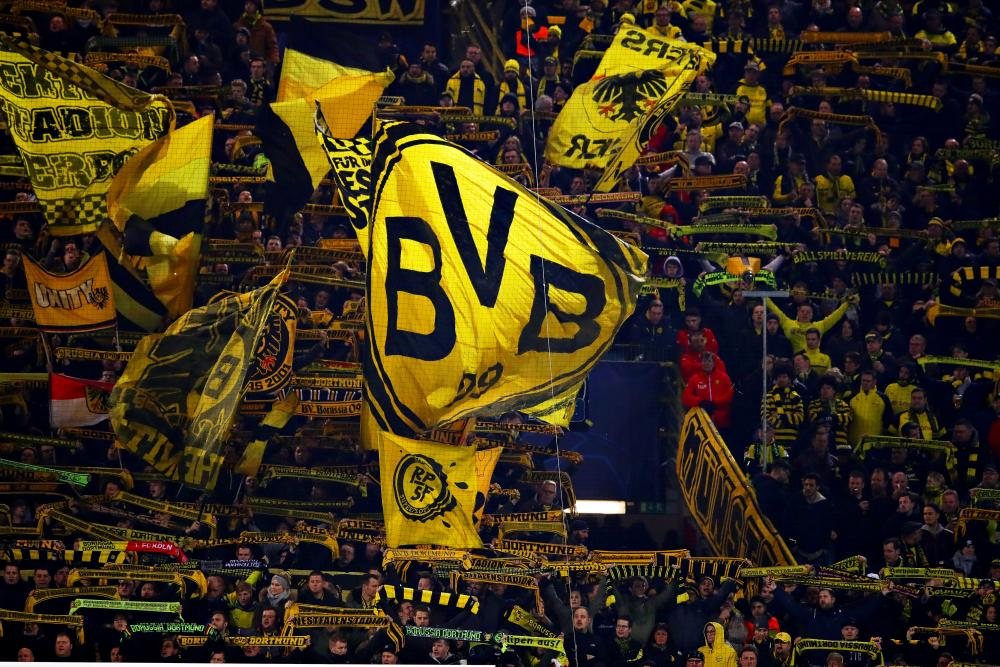 The Borussia Dortmund fans support their team.