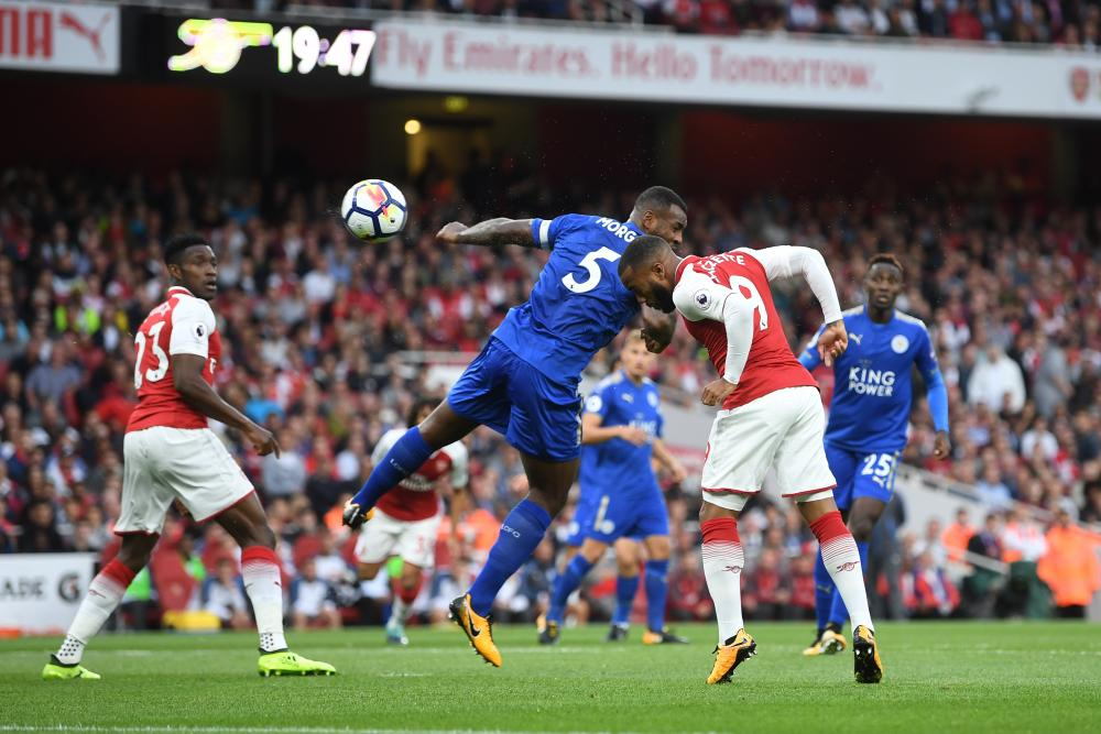 Alexandre Lacazette heads in the opening goal of the season.