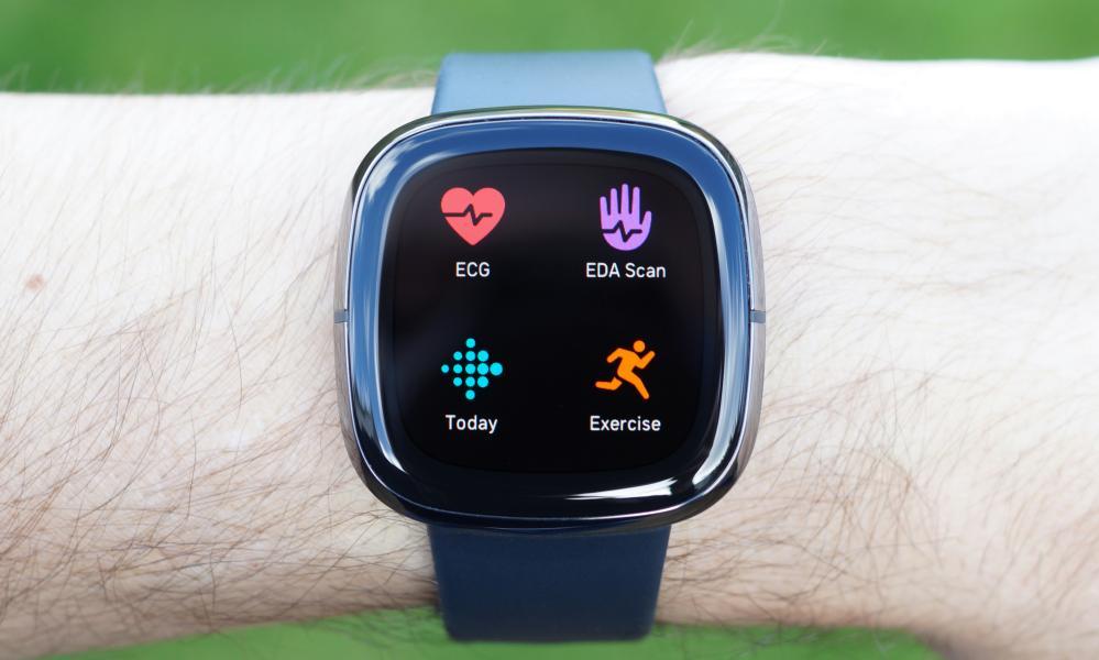 Fitbit Sense on wrist showing apps