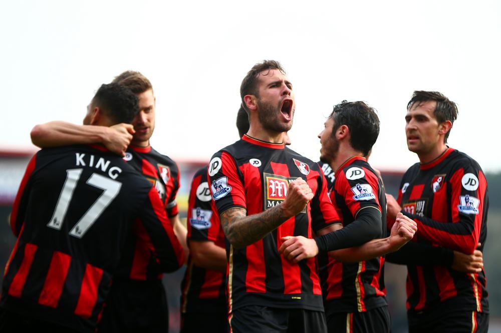 Steve Cook celebrates after scoring against Swansea City.