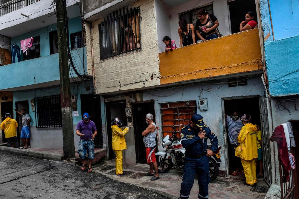 Local authorities interview residents at the Santa Cruz neighborhood in Medellin, Colombia.