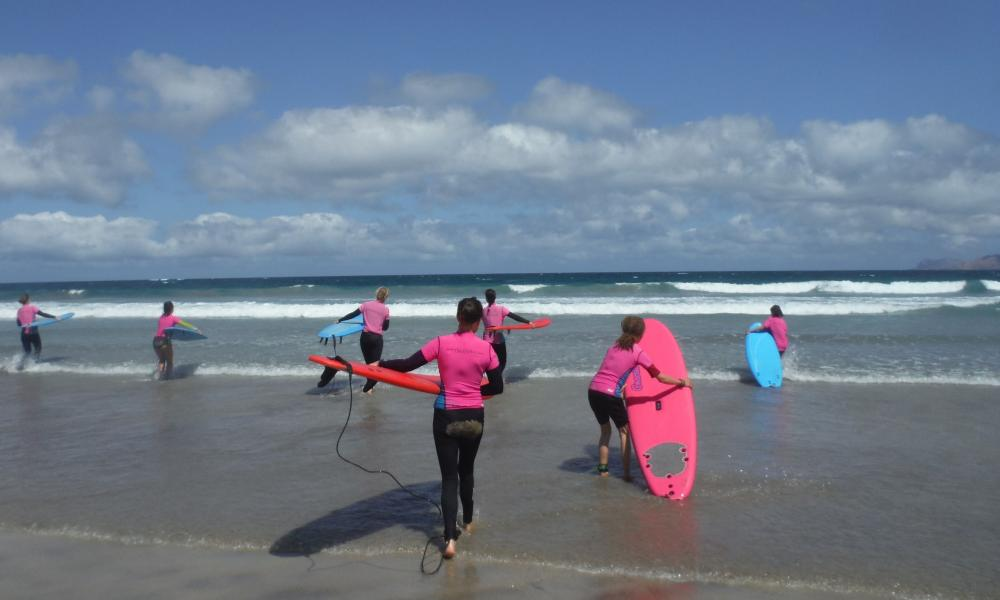 Women's Surfers on the beach in Lanzarote