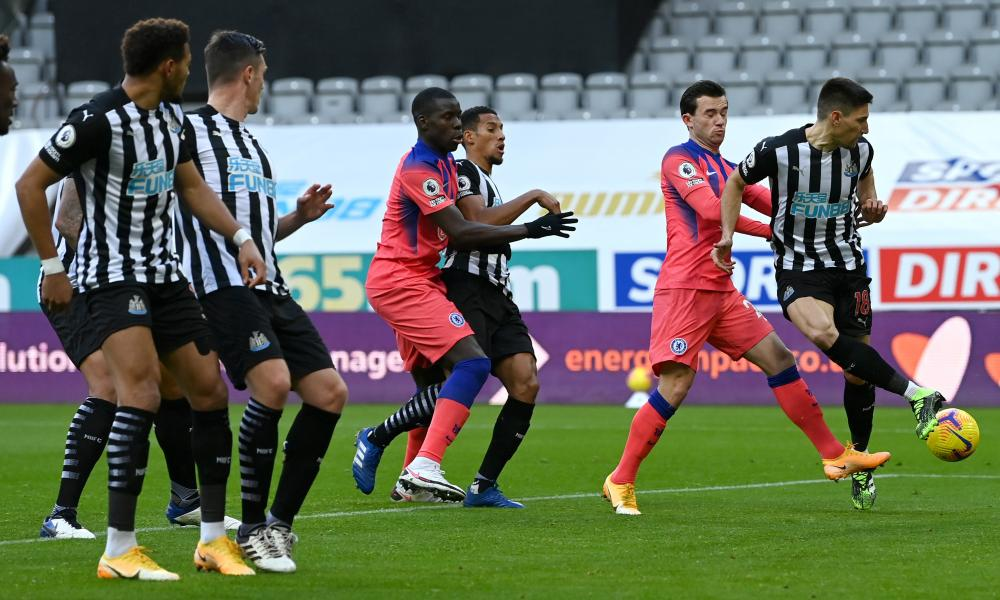 Federico Fernandez of Newcastle United scores an own goal.