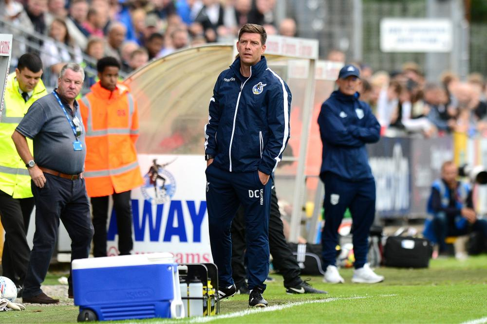 Bristol Rovers manager Darrell Clarke in the dugout during the pre-season friendly against West Bromwich Albion